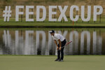 Viktor Hovland of Norway, lines up a putt on the 14th hole during the second round of the World Golf Championship-FedEx St. Jude Invitational Friday, July 31, 2020, in Memphis, Tenn. (AP Photo/Mark Humphrey)