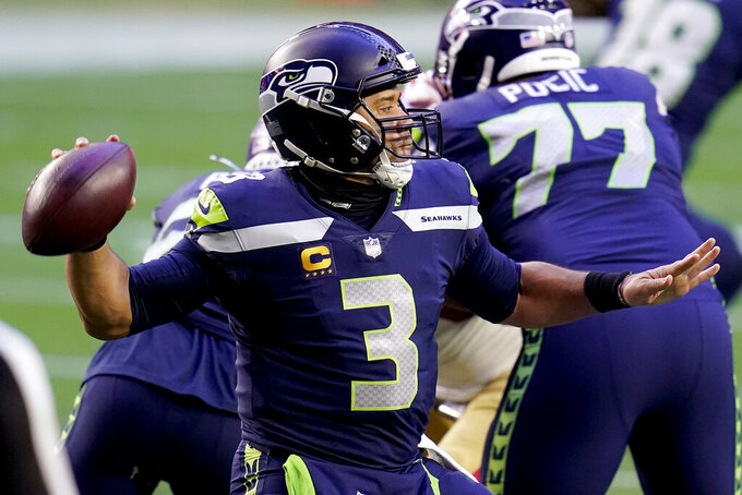 Seattle Seahawks quarterback Russell Wilson (3) throws against the San Francisco 49ers during the second half of an NFL football game, Sunday, Jan. 3, 2021, in Glendale, Ariz. (AP Photo/Ross D. Franklin)