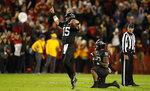 Iowa State quarterback Brock Purdy (15) celebrates with teammate David Montgomery (32) after an NCAA college football game against West Virginia, Saturday, Oct. 13, 2018, in Ames, Iowa. (AP Photo/Charlie Neibergall)