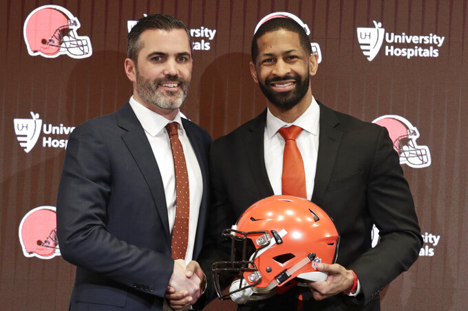 "FILE - In this Feb. 5, 2020, file photo, Cleveland Browns coach Kevin Stefanski, left, and general manager Andrew Berry pose for a photo after speaking during a news conference at the NFL football team's training facility in Berea, Ohio.Cleveland's three major professional sports franchises--the Browns, Cavaliers and Indians--are teaming up to fight social injustice. One day after the NBA postponed playoff games--and other leagues followed suit--amid a player-led boycott to protest the shooting of a Black man by police in Wisconsin, the Cleveland teams announced their alliance to ""develop a sustainable and direct strategy to address social injustice facing the city and all Northeast Ohio communities."" (AP Photo/Tony Dejak, File)"