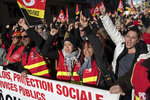 CGT Union protesters cheer at a march during a mass strike in Marseille, southern France, Tuesday, Dec. 10, 2019. French airport employees, teachers and other workers joined nationwide strikes Tuesday as unions cranked up pressure on the government to scrap upcoming changes to the country's national retirement system. (AP Photo/Daniel Cole)