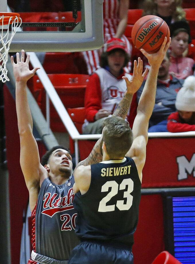 Colorado forward Lucas Siewert (23) shoots as Utah forward Timmy Allen (20) defends during the second half of an NCAA college basketball game Sunday, Jan. 20, 2019, in Salt lake City. (AP Photo/Rick Bowmer)