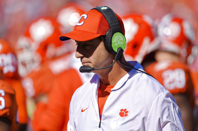 Clemson head coach Dabo Swinney walks the sidelines during the first half of an NCAA college football game against Louisville, Saturday, Nov. 3, 2018, in Clemson, S.C. (AP Photo/Richard Shiro)