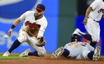 Cleveland Indians' Jason Kipnis waits for the ball as Detroit Tigers' Niko Goodrum steals second base during the seventh inning of a baseball game Thursday, July 18, 2019, in Cleveland. (AP Photo/David Dermer)