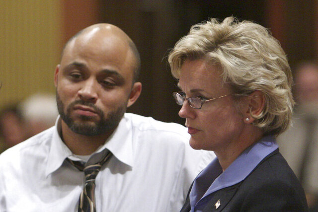 FILE - in this Sept. 28, 2007 file photo, Michigan Gov. Jennifer Granholm, right, appears with state Rep. Morris Hood III, D-Detroit, during a House session at the state Capitol in Lansing, Mich. Complications from the COVID-19 virus have claimed the life of Hood, a former Democratic state legislator from Detroit. Wayne County Executive Warren Evan's office said Tuesday, May 12, 2020, that Hood's family confirmed his death. Hood died Monday, May 11. He was 54. (AP Photo/Al Goldis)