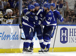 Tampa Bay Lightning right wing Nikita Kucherov (86) celebrates with teammates, including Victor Hedman (77), and Steven Stamkos (91) after scoring against the Boston Bruins during the third period of an NHL hockey game Monday, March 25, 2019, in Tampa, Fla. (AP Photo/Chris O'Meara)