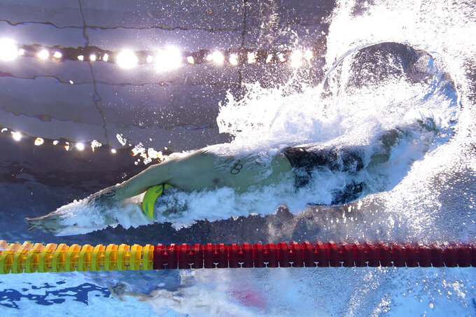 Australia's Kyle Chalmers dives in at the start of a 100-meter freestyle heat at the 2020 Summer Olympics, Tuesday, July 27, 2021, in Tokyo. (AP Photo/David J. Phillip)