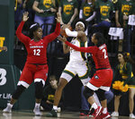Baylor forward NaLyssa Smith, center, is pressured by Georgia guard Gabby Connally, right, and Kaila Hubbard, left, in the first half of an NCAA college basketball game, Wednesday, Dec. 4, 2019, in Waco, Texas. (Rod Aydelotte/Waco Tribune-Herald via AP)