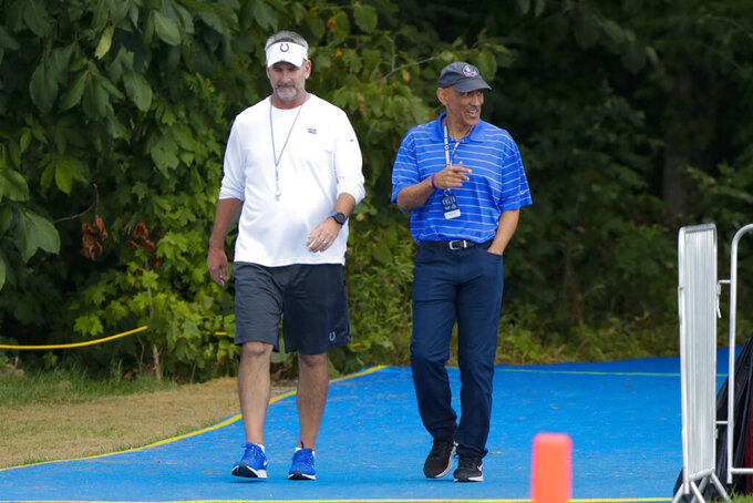 Indianapolis Colts head coach Frank Reich walks to the field with former Colts coach Tony Dungy practice at the NFL team's football training camp in Westfield, Ind., Thursday, Aug. 15, 2019. The Colts held a joint practice with the Cleveland Browns. (AP Photo/Michael Conroy)
