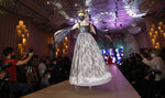 A model wearing a face mask takes part in a mask fashion show in Seoul, South Korea, Friday, July 24, 2020. (AP Photo/Lee Jin-man)