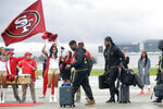 San Francisco 49ers free safety Jimmie Ward, center left, and cornerback Richard Sherman board a plane as the team departs from Mineta San Jose International Airport in San Jose, Calif., for Miami, Sunday, Jan. 26, 2020. The 49ers will face the Kansas City Chiefs in Super Bowl 54. (AP Photo/Jeff Chiu)