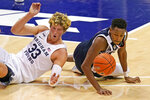 Gonzaga guard Joel Ayayi, right, and BYU forward Caleb Lohner (33) go after a loose ball in the first half of an NCAA college basketball game, Monday, Feb. 8, 2021, in Provo, Utah. (AP Photo/Rick Bowmer)