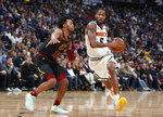 Denver Nuggets guard Will Barton, right, drives past Cleveland Cavaliers guard Darius Garland during the first half of an NBA basketball game Saturday, Jan. 11, 2020, in Denver. (AP Photo/David Zalubowski)