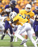 FILE - In this Aug. 30, 2018, file photo, Montana State cornerback Tyrel Thomas takes down Western Illinois' Steve McShane, left, during an NCAA college football game in Bozeman, Mont. Western Illinois plays at Illinois this week. (Rachel Leathe/Bozeman Daily Chronicle via AP, File)