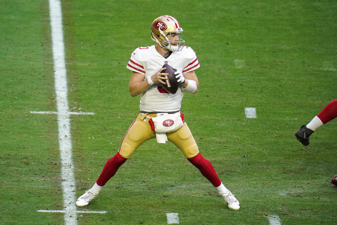 San Francisco 49ers quarterback C.J. Beathard looks to pass against the Seattle Seahawks during the first half of an NFL football game, Sunday, Jan. 3, 2021, in Glendale, Ariz. (AP Photo/Ross D. Franklin)