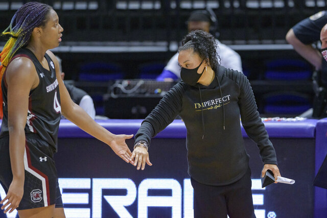 South Carolina head coach Dawn Staley celebrates with South Carolina forward Aliyah Boston (4) during an NCAA basketball game against LSU in Baton Rouge, La., Sunday, Jan. 24, 2021. (AP Photo/Matthew Hinton)