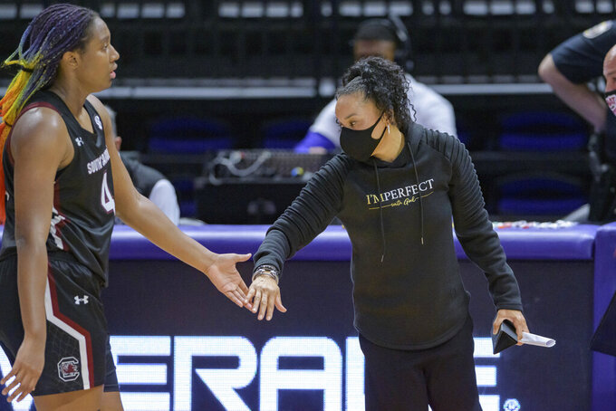 South Carolina head coach Dawn Staley celebrates with South Carolina forward Aliyah Boston (4) during an NCAA basketball game against LSU in Baton Rouge, La., Sunday, Jan. 24, 2021. (AP Photo/Matthew Hinton)