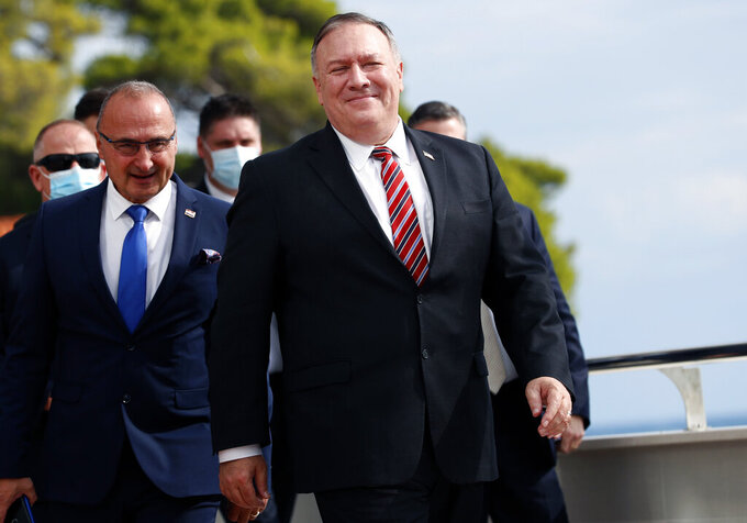 """FILE - In this Oct. 2, 2020, file photo, U.S. Secretary of State Mike Pompeo, right, with Croatia's Foreign Minister Gordan Grlic Radman, arrives for a press conference after talks in Dubrovnik, Croatia. The foreign ministers from four Indo-Pacific nations known as the Quad group will gather in Tokyo Wednesday for talks in hopes of stepping up their cooperation and take leadership in a regional initiative to counter China's growing assertiveness and influence. On his way to Tokyo, Pompeo told traveling reporters that the four countries have been preparing and hoped to have some """"significant achievements"""" at the meeting, but he did not elaborate. (AP Photo/Darko Bandic, File)"""