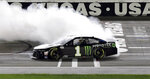 Kurt Busch performs a burnout after winning a NASCAR Cup Series auto race Sunday, Sept. 27, 2020, in Las Vegas. (AP Photo/Isaac Brekken)