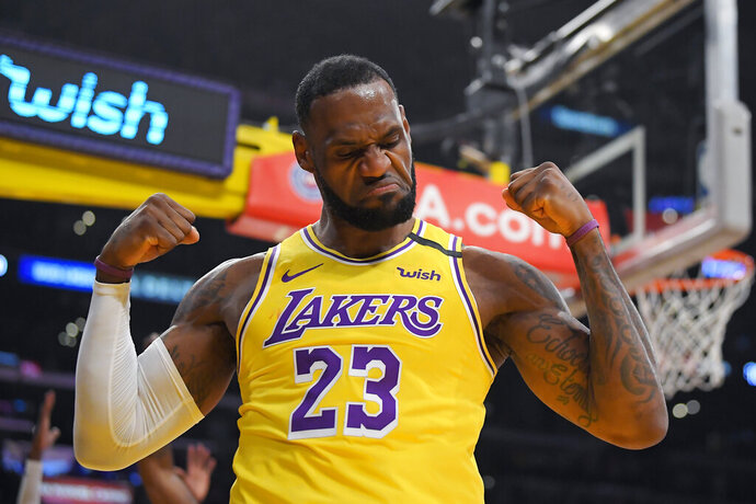 Los Angeles Lakers forward LeBron James gestures after scoring and drawing a foul during the first half of the team's NBA basketball game against the New York Knicks on Tuesday, Jan. 7, 2020, in Los Angeles. (AP Photo/Mark J. Terrill)