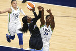 Chicago Sky's Kahleah Copper shoots as  Minnesota Lynx center Sylvia Fowles (34) defends during the first half of a WNBA basketball game Tuesday, June 15, 2021, in Minneapolis. (AP Photo/Stacy Bengs)