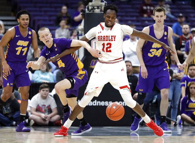 Northern Iowa's AJ Green (4) and Bradley's Koch Bar (12) chase the ball during the first half of an NCAA college basketball game in the championship of the Missouri Valley Conference tournament, Sunday, March 10, 2019, in St. Louis. (AP Photo/Jeff Roberson)