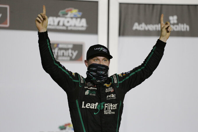 Justin Haley celebrates in Victory Lane after winning a NASCAR Xfinity auto race at Daytona International Speedway, Friday, Aug. 28, 2020, in Daytona Beach, Fla. (AP Photo/Terry Renna)
