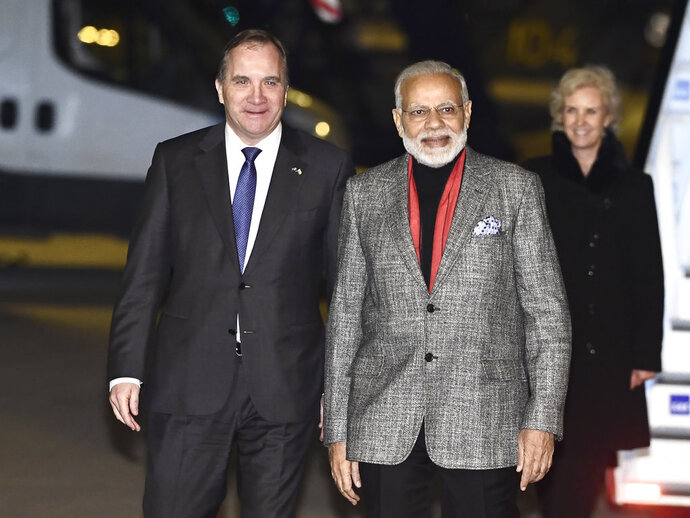 India's Prime Minister Narendra Modi, centre, is greeted by Swedish Prime Minister Stefan Lofven, left, on his arrival at Arlanda Airport in Stockholm, Sweden, Monday April 16, 2018. (Claudio Bresciani / TT via AP)