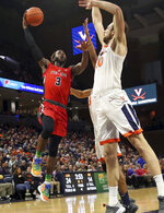 Stony Brook guard Elijah Olaniyi (3) shoots next to Virginia forward Jay Huff (30) during an NCAA college basketball game in Charlottesville, Va., Wednesday, Dec. 18, 2019. (AP Photo/Andrew Shurtleff)