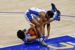 Pittsburgh's Femi Odukale (2) and Duke's Jeremy Roach scramble for a loose ball during the second half of an NCAA college basketball game Tuesday, Jan. 19, 2021, in Pittsburgh. (AP Photo/Keith Srakocic)