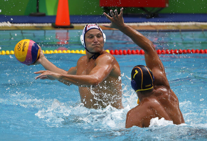 FILE - In this Aug. 8, 2016, file photo, United States' Jesse Smith, left, shoots as Spain's Balasz Sziranyi Somogyi defends during their men's water polo preliminary round match at the Summer Olympics in Rio de Janeiro, Brazil. Smith is heading to his record-tying fifth Olympics after he was selected Friday, July 2, 2021, for the U.S. men's water polo team for the Tokyo Games. (AP Photo/Eduardo Verdugo, File)