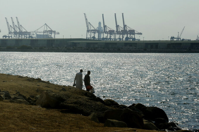 Visitors prepare to fish in front of the Red Sea port, in Jiddah, Saudi Arabia, Monday, Dec.14, 2020. An explosion rocked a ship off Saudi Arabia's port city of Jiddah on the Red Sea, authorities said Monday, without elaborating. (AP Photo/Amr Nabil)