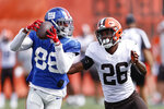New York Giants wide receiver Darius Slayton (86) catches a pass against Cleveland Browns cornerback Greedy Williams (26) during a joint NFL football training camp practice Thursday, Aug. 19, 2021, in Berea, Ohio. (AP Photo/Ron Schwane)