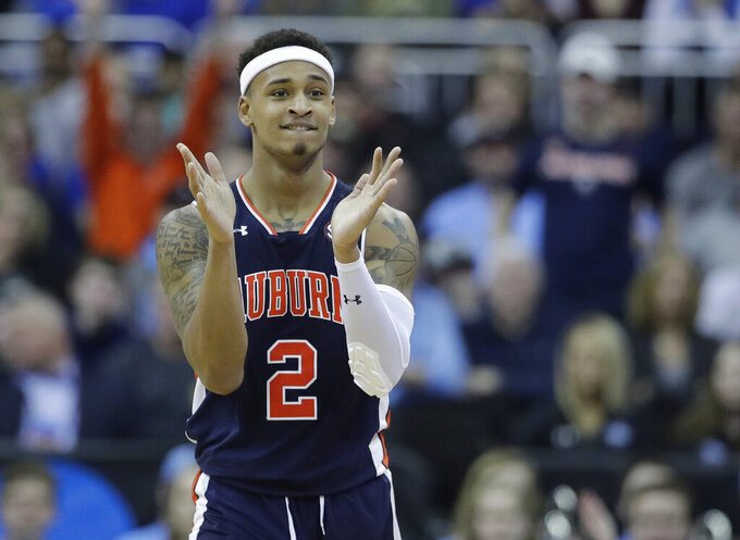Auburn's Bryce Brown applauds during the second half of a men's NCAA tournament college basketball Midwest Regional semifinal game against North Carolina Friday, March 29, 2019, in Kansas City, Mo. (AP Photo/Charlie Riedel)