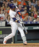 Houston Astros' Yuli Gurriel hits a two-run single against the Oakland Athletics during the fourth inning of a baseball game Wednesday, July 11, 2018, in Houston. (AP Photo/David J. Phillip)