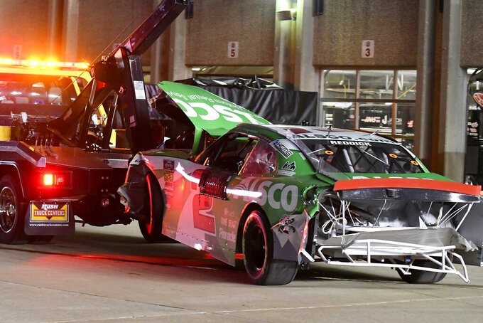 Tyler Reddick's car is towed to the garage area after Reddick crashed late in the NASCAR Xfinity Series auto race at Texas Motor Speedway in Fort Worth, Texas, Saturday, Nov. 2, 2019. (AP Photo/Randy Holt)