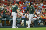 Marcus Semien, right, is congratulated by third base coach Matt Williams (4) as he runs the bases after hitting a solo home run during the fifth inning of the team's baseball game against the St. Louis Cardinals on Tuesday, June 25, 2019, in St. Louis. (AP Photo/Scott Kane)