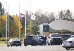 Police were set up in front of the community center on the Fond Du Lac band reservation, near Cloquet, Minn., Friday, Oct. 18, 2019, where a man was shot. One man was shot and a suspect was arrested after a shooting Friday on an American Indian reservation in northern Minnesota that prompted a lockdown of tribal offices and a school. (Alex Kormann/Star Tribune via AP)