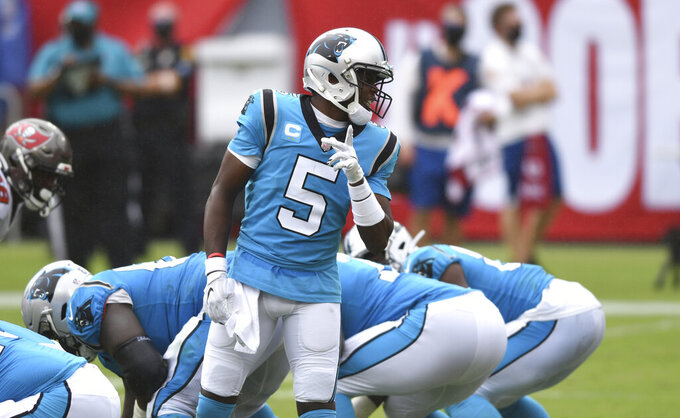 Carolina Panthers quarterback Teddy Bridgewater (5) calls a play against the Tampa Bay Buccaneers during the second half of an NFL football game Sunday, Sept. 20, 2020, in Tampa, Fla. (AP Photo/Jason Behnken)