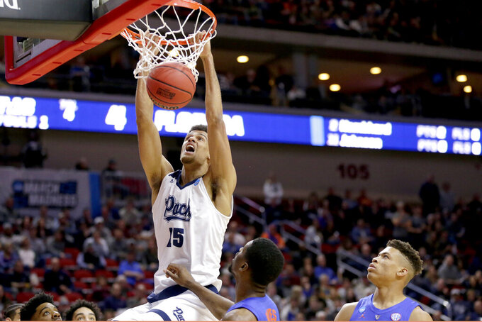 Nevada's Trey Porter (15) dunks against Florida during the first half of a first round men's college basketball game in the NCAA Tournament in Des Moines, Iowa, Thursday, March 21, 2019. (AP Photo/Nati Harnik)