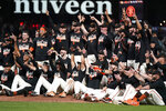 San Francisco Giants players celebrate after defeating the San Diego Padres in a baseball game to clinch a postseason berth in San Francisco, Monday, Sept. 13, 2021. (AP Photo/Jeff Chiu)