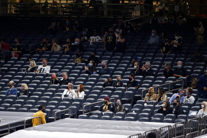 A portion of the 3,000 fans allowed in the Superdome sit socially distanced in the second half of an NFL football game between the New Orleans Saints and the Carolina Panthers in New Orleans, Sunday, Oct. 25, 2020. (AP Photo/Butch Dill)