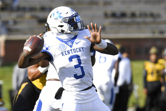 Kentucky quarterback Terry Wilson throws during the first half of an NCAA college football game against Missouri Saturday, Oct. 24, 2020, in Columbia, Mo. (AP Photo/L.G. Patterson)