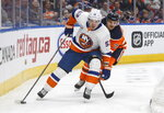 New York Islanders' Casey Cizikas (53) is chased by Edmonton Oilers' Andrej Sekera (2) during first-period NHL hockey game action in Edmonton, Alberta, Thursday, Feb. 21, 2019. (Jason Franson/The Canadian Press via AP)