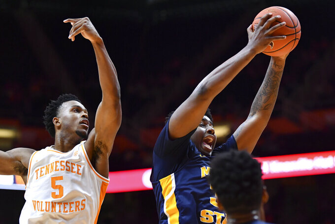 Murray State forward Darnell Cowart gets the rebound next to Tennessee guard Josiah-Jordan James (5) during an NCAA college basketball game Tuesday, Nov. 12, 2019, in Knoxville, Tenn. (Saul Young/Knoxville News Sentinel via AP)