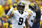 Iowa defensive back Geno Stone (9) celebrates his interception during the first half of an NCAA college football game against Michigan in Ann Arbor, Mich., Saturday, Oct. 5, 2019. (AP Photo/Paul Sancya)