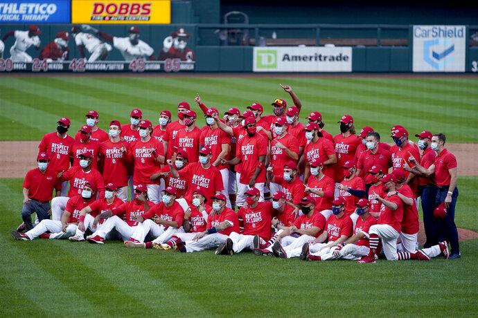Members of the St. Louis Cardinals celebrate after defeating the Milwaukee Brewers in a baseball game to earn a playoff birth Sunday, Sept. 27, 2020, in St. Louis. (AP Photo/Jeff Roberson)