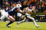Mississippi quarterback John Rhys Plumlee (10) scrambles as Auburn linebacker Chandler Wooten (31) pressures him during the second half of an NCAA college football game Saturday, Nov. 2, 2019, in Auburn, Ala. (AP Photo/Butch Dill)