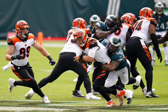 Cincinnati Bengals' Joe Burrow (9) is tackled by Philadelphia Eagles' Derek Barnett (96) during the first half of an NFL football game, Sunday, Sept. 27, 2020, in Philadelphia. (AP Photo/Chris Szagola)