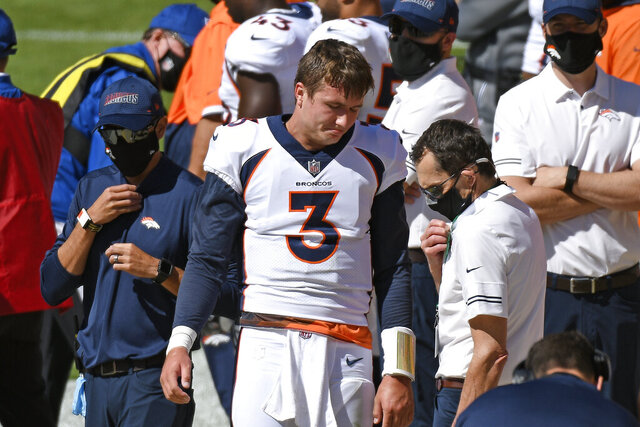 Denver Broncos quarterback Drew Lock (3) stands on the sideline after being injured during the first half of an NFL football game against the Pittsburgh Steelers in Pittsburgh, Sunday, Sept. 20, 2020. (AP Photo/Don Wright)